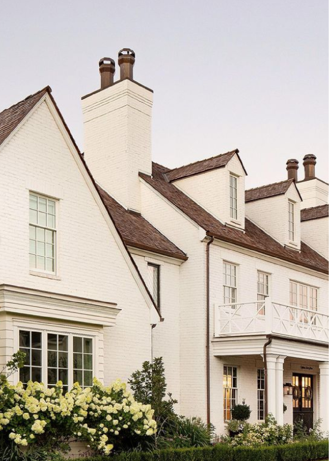 Traditional style white brick painted house exterior with dormers and timeless style by The Fox Group. #houseexteriors #whitebrick #whitehouses