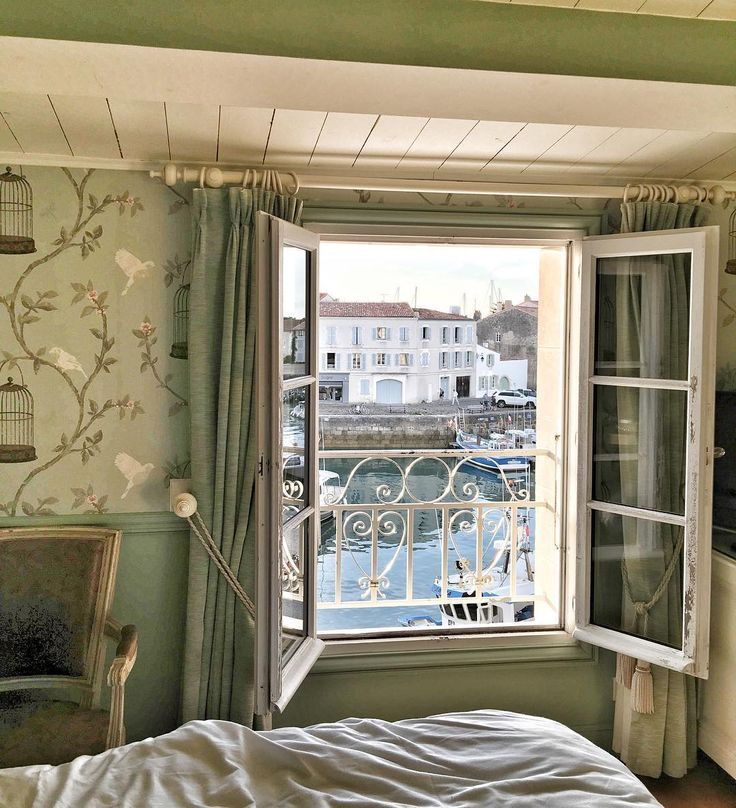 Romantic suite at Hotel Toiras in Ile de Re with windows open to the French air. Photo by Vivi et Margot.