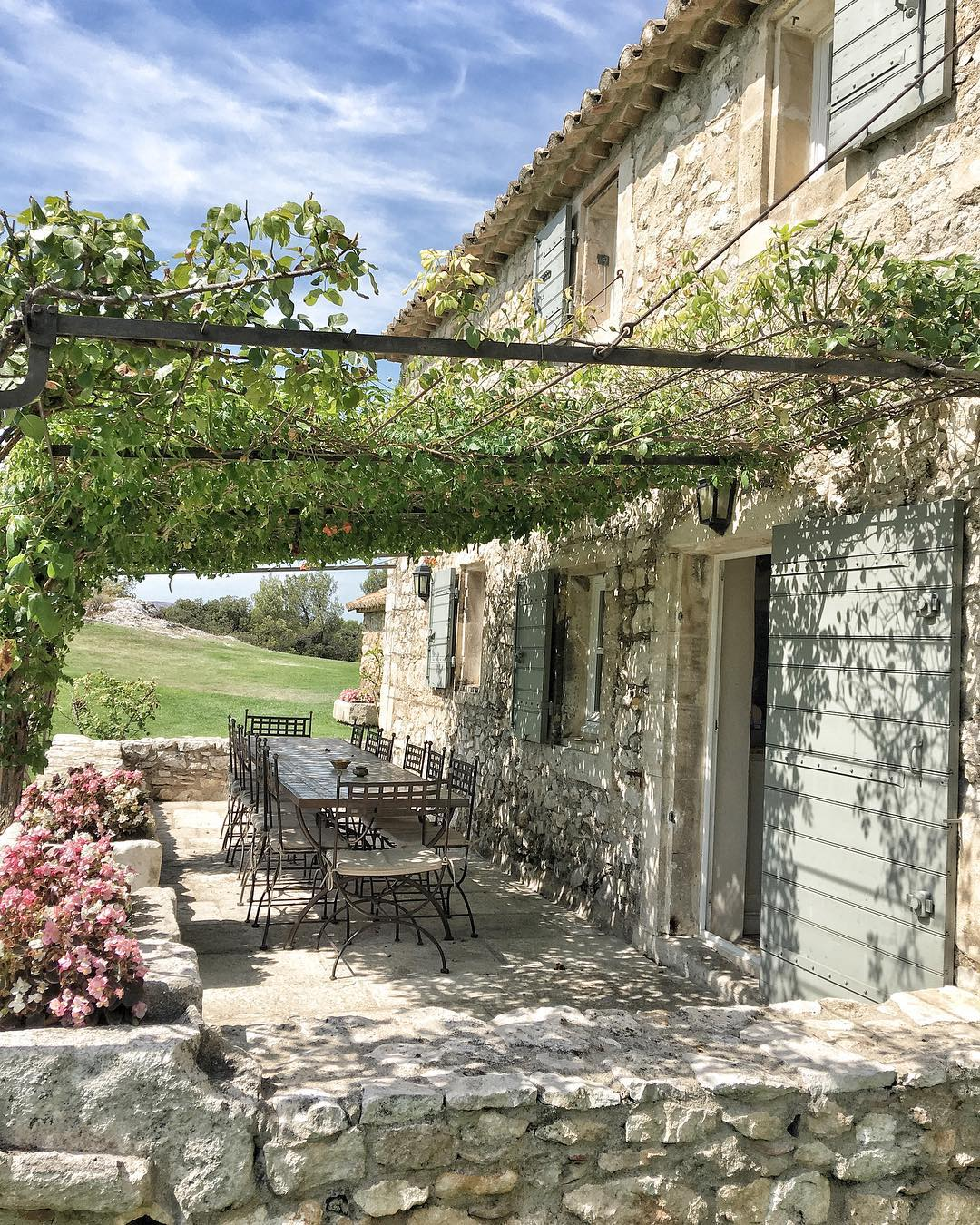 Charming stone exterior of a farmhouse in France - photo by Vivi et Margot.