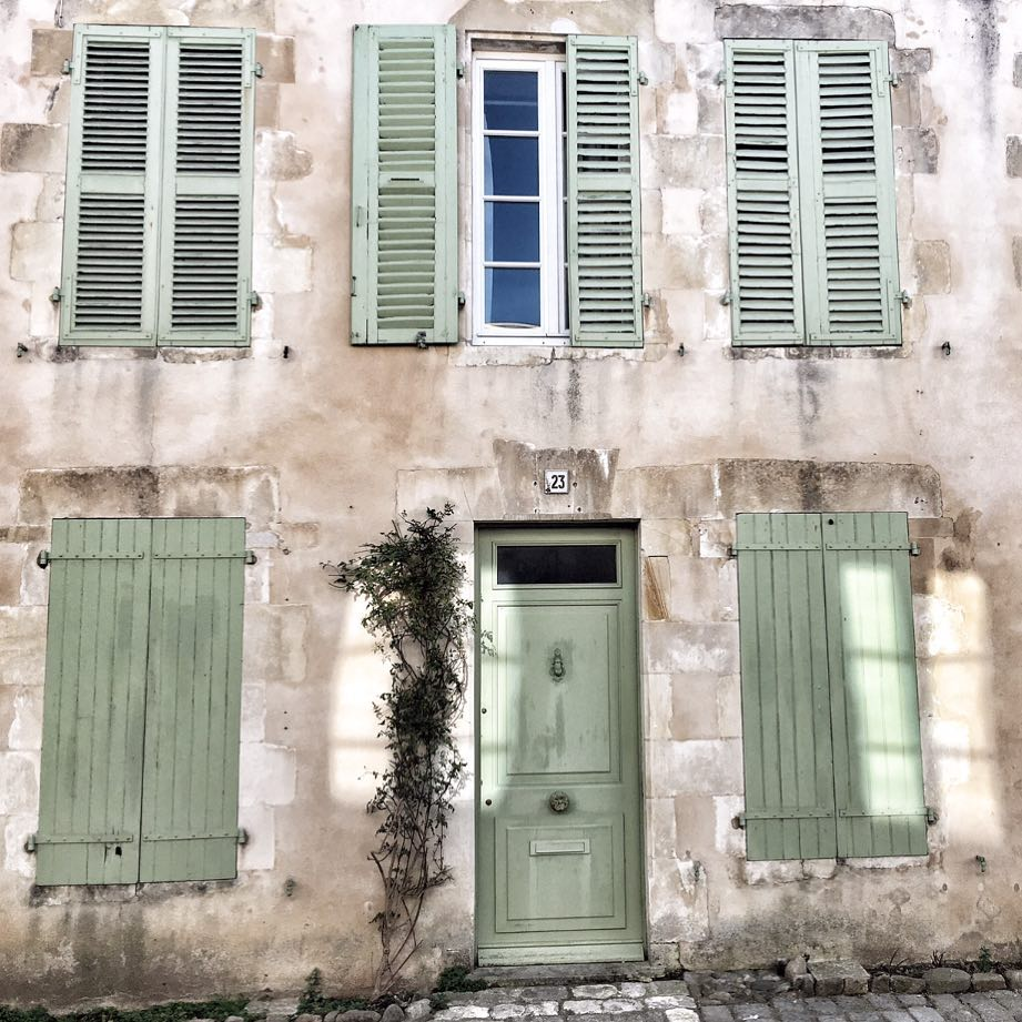 Charming and rustic French farmhouse exterior with Vert Olivier Green Shutters - photo by Vivi et Margot.