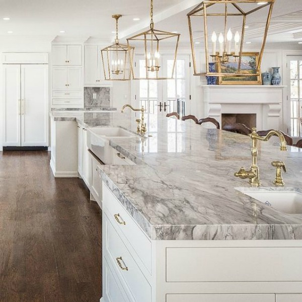 Elegant timeless kitchen with marble countertop and brass lantern island pendants - design by The Fox Group.  Click through for 9 Tranquil, Traditional, Timeless Interior Design Ideas & Inspiring House Exteriors: The Fox Group!