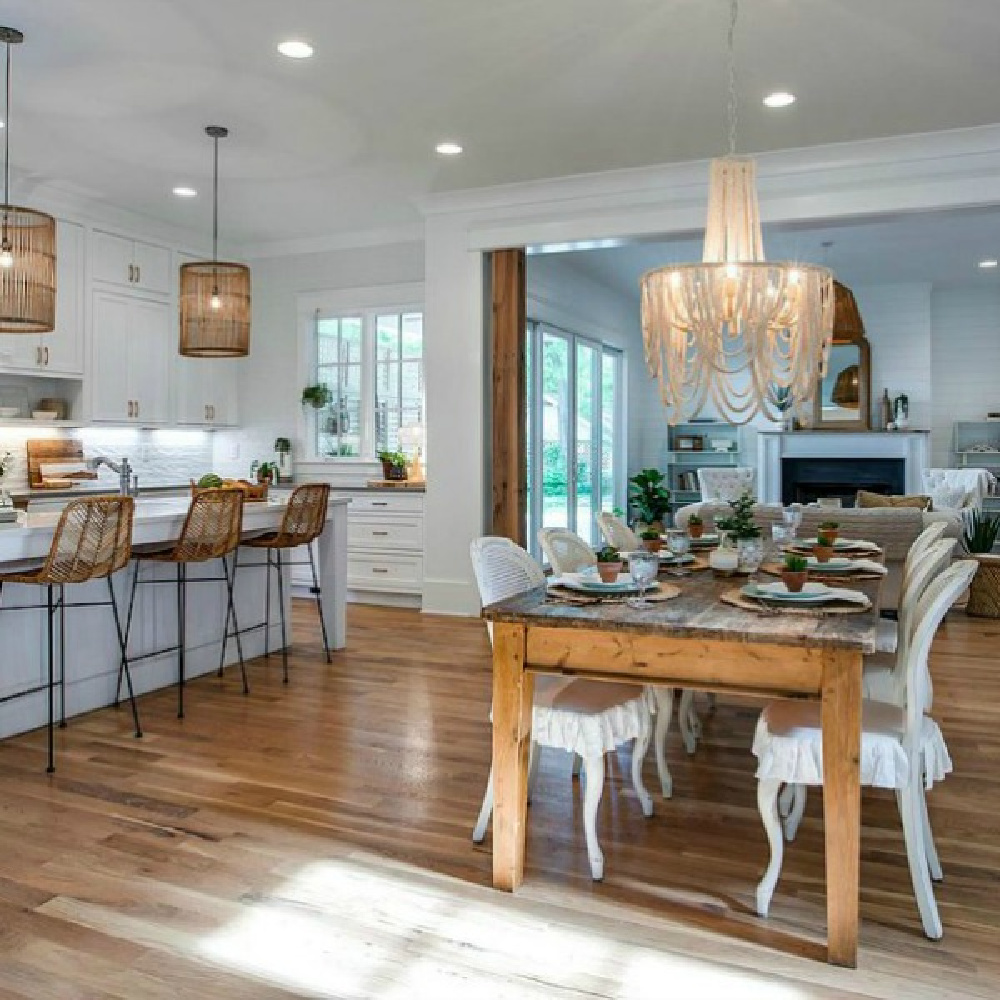 Breezy southern beachy charm in a white kitchen and breakfast area with plenty of natural finishes and hardwoods in a Tennessee cottage.