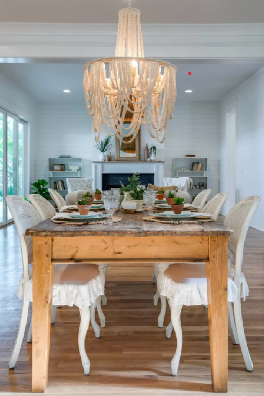 Country French farmhouse dining area with rustic farm table and cane back Louis style chairs in a Tennessee cottage in Franklin.