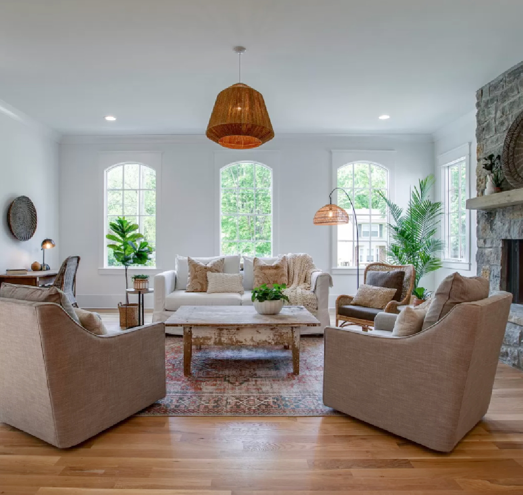 Rustic elegant cottage style in a breezy den with arched windows and laid back furnishings in Franklin, TN.
