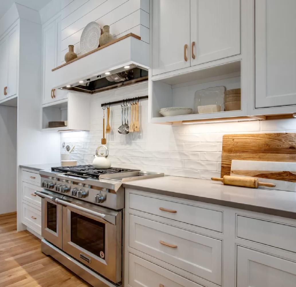 Beautiful Shaker kitchen with pro range and textured white ceramic backsplash. #whitekitchens #kitchendesign