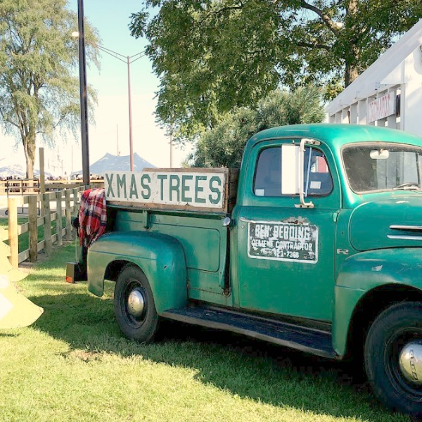 Vintage Chritmas Tree farm truck! Autumn inspiration, Fall farmhouse style decor, vintage wares, and handmade treasures mingle at Main Street Market (Urban Farmgirl) in Belvidere, Illinois - Hello Lovely Studio. #fleamarket #farmhousestyle #vintage #junkin