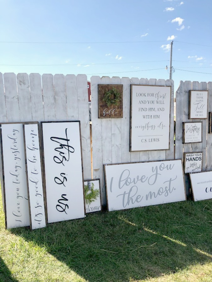 Hand-lettered signs with messages of faith. Come discover rustic fall decorating ideas in this photo gallery with ideas and resources! Vintage style, farmhouse decor, and junkin paradise in the fall - Main Street Market (Urban Farmgirl) in Belvidere, IL - Hello Lovely Studio. #fleamarket #vintage #farmhouse #countrydecor #midwest