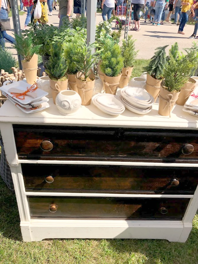 Greenery on a vintage dresser. Come discover rustic fall decorating ideas in this photo gallery with ideas and resources!   Vintage style, farmhouse decor, and junkin paradise in the fall - Main Street Market (Urban Farmgirl) in Belvidere, IL - Hello Lovely Studio. #fleamarket #vintage #farmhouse #countrydecor #midwest