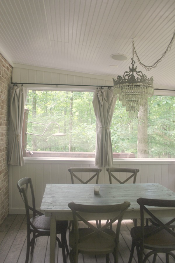 Screened porch in a rustic farmhouse style Storybook Cottage near Franklin, TN - Hello Lovely Studio. #porch #storybookcottage #farmhousestyle