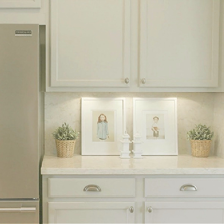 Behr Classic Silver paint color on kitchen cabinets in Hello Lovely's serene kitchen makeover with Viatera Soprano quartz. #hellolovelystudio #kitchendesign #paintcolors #behrclassicsilver #viaterasoprano #quartzcountertop #quartzbacksplash #kitchenaidappliances