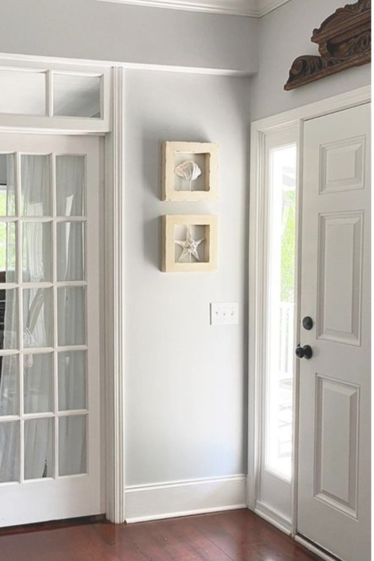 Entry walls are painted Behr Sterling (a light grey with blue undertones) and paired with white moldings - This Girl Paints. #behrsterling #lightgrey #paintcolors #greypaint