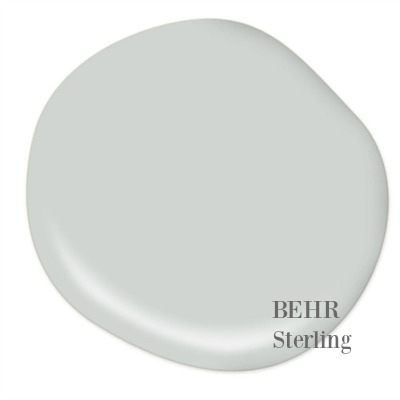 BEHR Sterling paint color is a gorgeous muted blue-grey with a tranquil and serene timeless feel. I used it in our laundry room and love it! Hello Lovely Studio.
