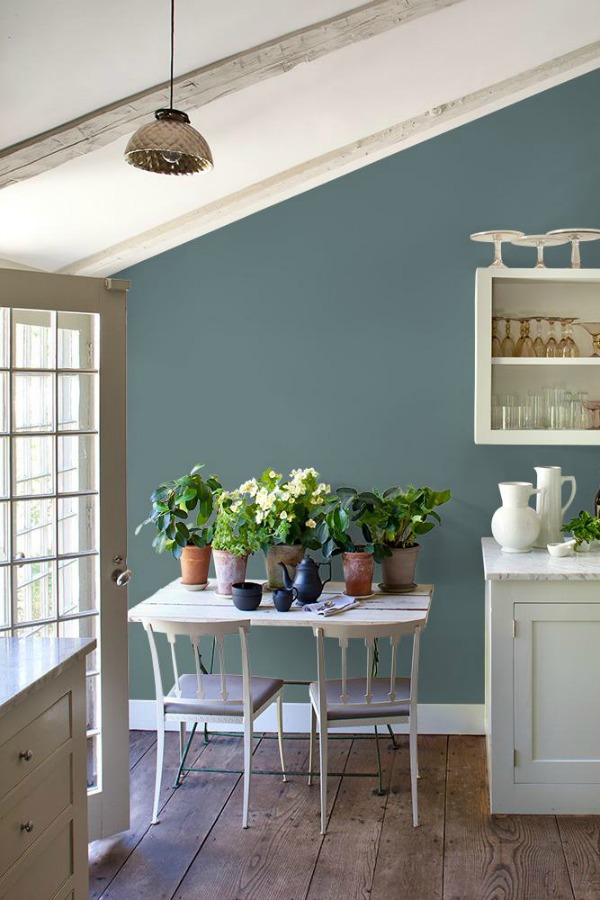 Blue Blood PPG paint color for walls of a white kitchen with farmhouse style.