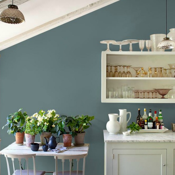 Blue Blood PPG paint color on walls of a rustic kitchen with blue and white.