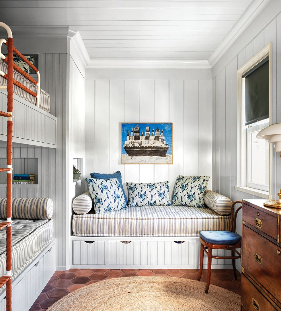 Coastal style bunk room with built-ins and blue accents is a delightful design by Tom Scheerer, photo by Francesco Lagnese. Elle Decor.