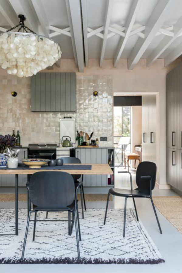 Zellige tiled statement wall in a kitchen with magnificent architecture. Stunning and soulful space designed by Imperfect Interiors in the UK - this East Dulwich Industrial Conversion sings!