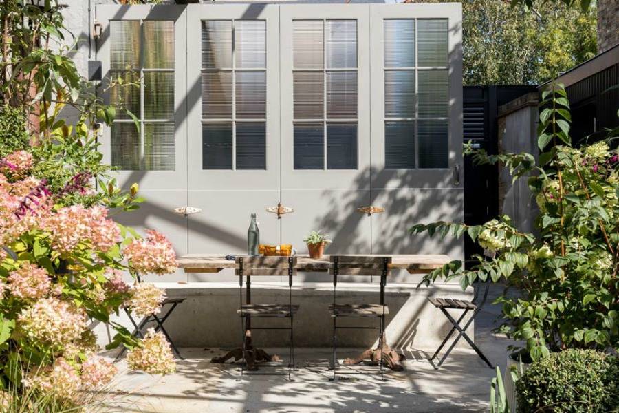 Charming outdoor dining. Stunning and soulful space designed by Imperfect Interiors in the UK - this East Dulwich Industrial Conversion sings!