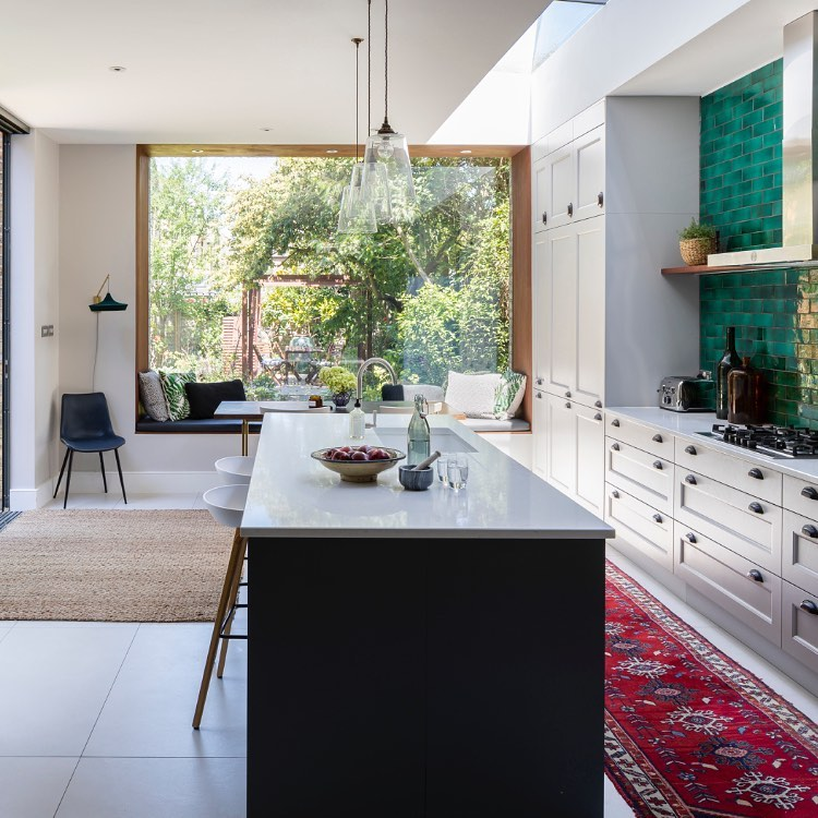 Beautiful bespoke English kitchen with grand picture window - Imperfect Interiors. #kitchendesign #bespokekitchen #picturewindow
