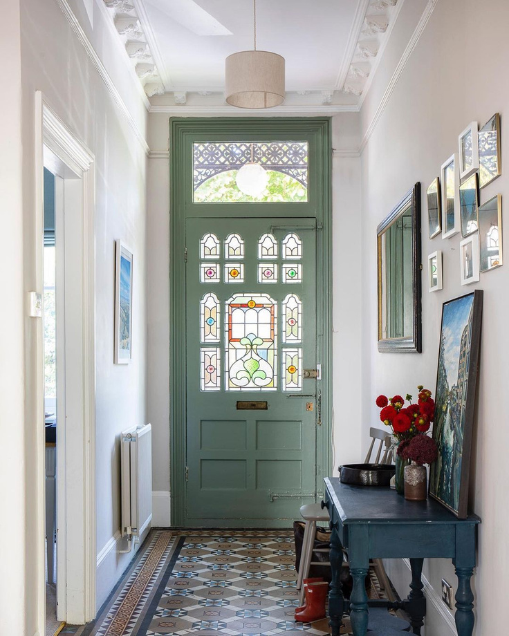 Beautiful entry in an English home with stunning sage green painted door - Imperfect Interiors. #entry #interiordesign #classicdesign #victorianhome #englishhome #sagegreen #greenpaint