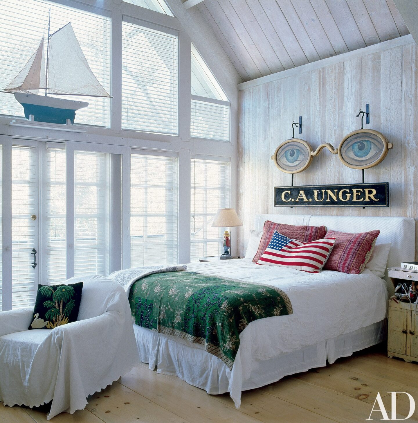Lofty farmhouse rustic bedroom with white planked walls in the LA home of Malcolm McDowell. Photo by Miguel Flores-Vianna for Architectural Digest. Timeless Tastemaker Trifecta: Lisa Fine, Tom Scheerer and Miguel Flores-Vianna...in case you admire sophisticated design.