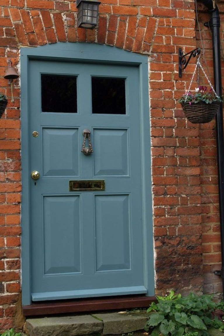 Beautiful Blue Gray (Farrow & Ball) paint color on front door of charming vintage European home with red brick - Verf Behang Marco van den Berg. #farrowandballbluegray #graypaintcolors #bluegray #paintcolors