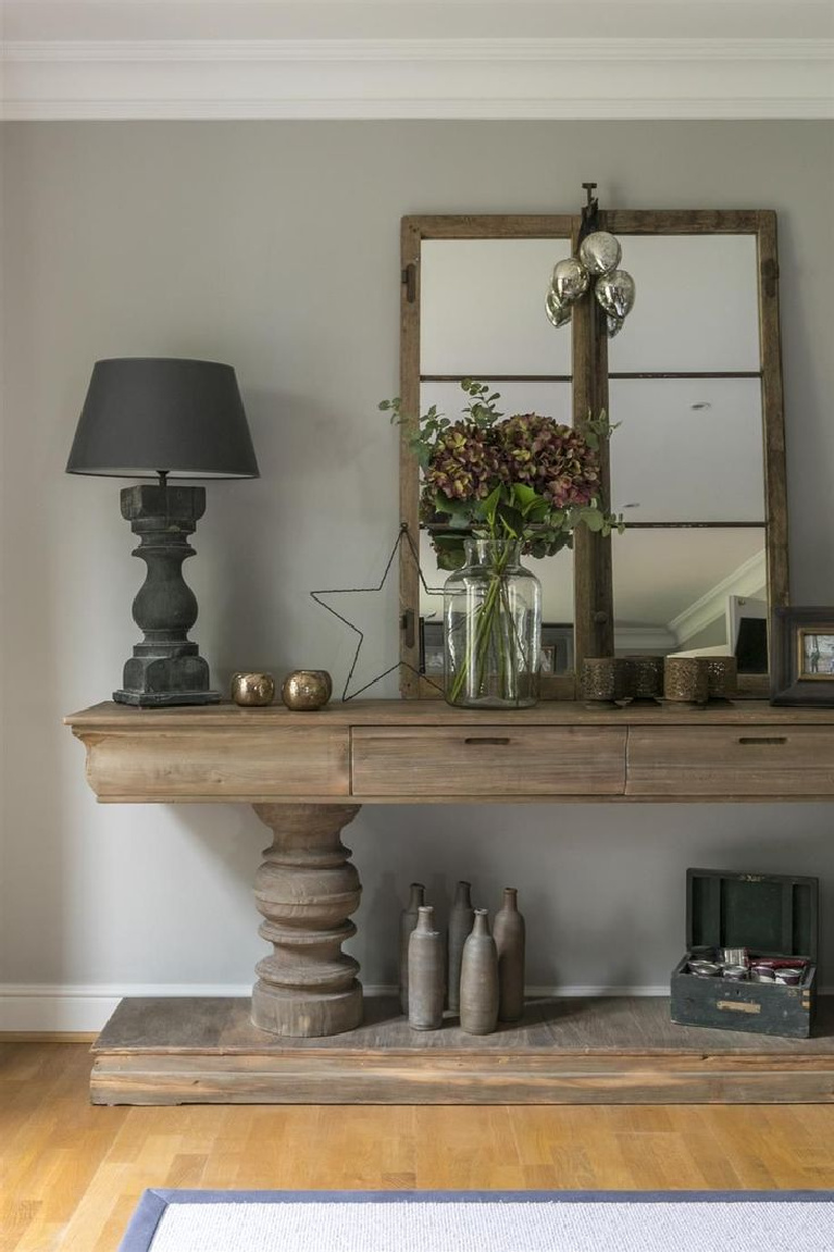 Farrow & Ball Pavilion Gray paint color on walls with beautiful rustic wood console and European country inspired decor - @Emilycoco. #paviliongray #farrowandball #paintcolors #graypaints