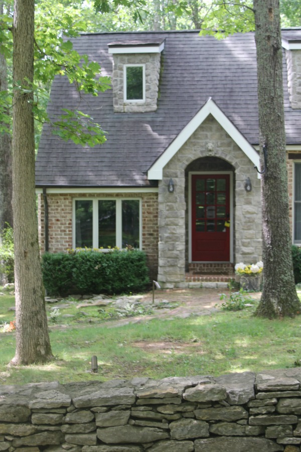 Exterior of cottage. Secluded, woodsy, equestrian acreage at Storybook Cottage near Franklin, TN - Hello Lovely Studio.