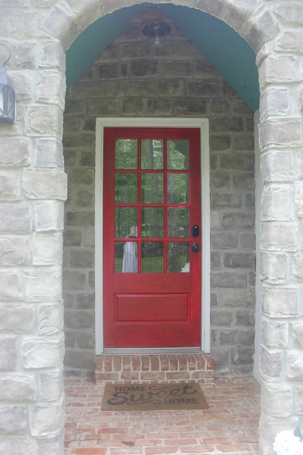 Red front door at Storybook Cottage in Leiper's For, Tennessee - Hello Lovely Studio.