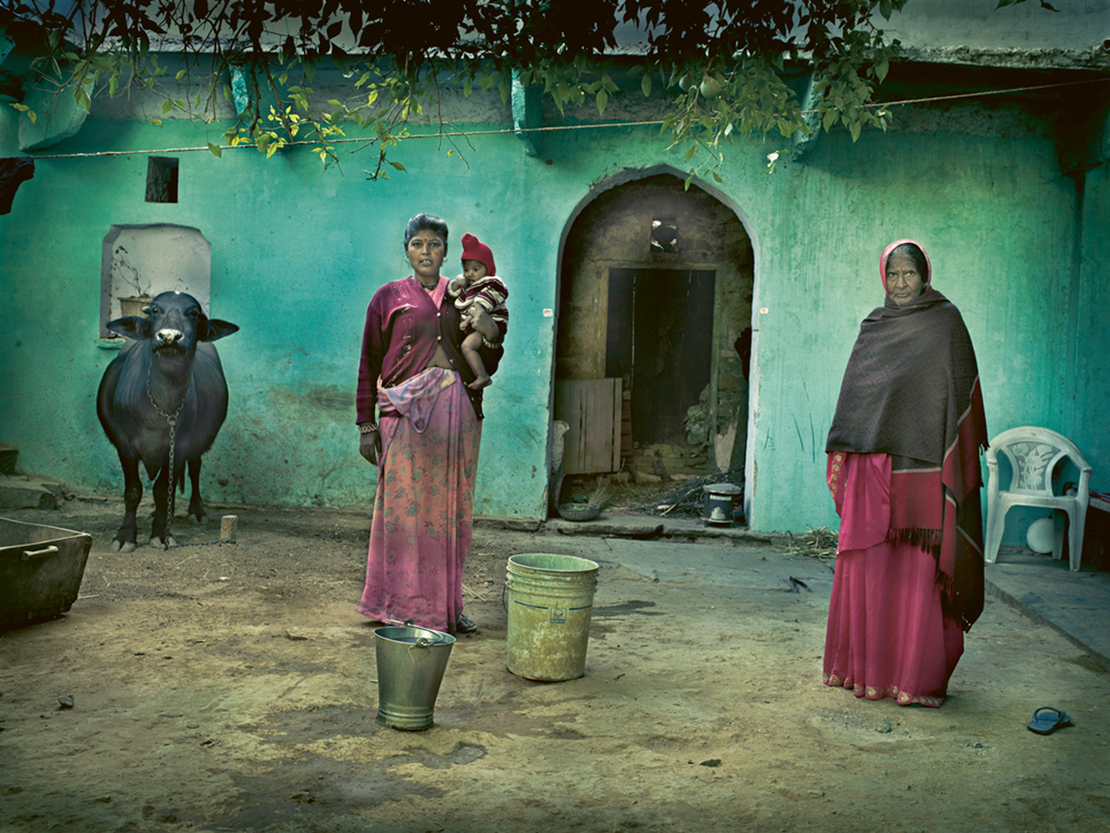 Women in India with turquoise home and cow. Photo © Andreas H. Bitesnich. All rights reserved. Come discover 3 Inspiring Art & Design Books on My Nightstand This Minute I Am Loving!