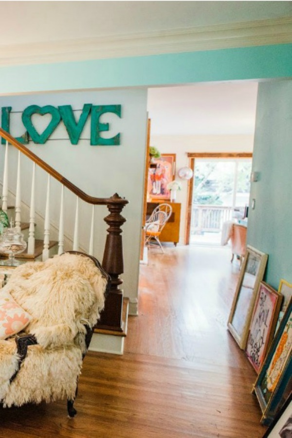 Be inspired by this photo gallery of vibrant colorful beachy boho interior design from artist Jenny Sweeney's Chicagoland home. Her art has been lifting spirits and opening hearts to wonder - see how it lives large in a charming suburban Tudor!