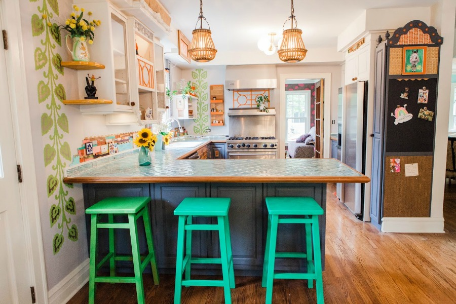 Bright green kitchen stools. Be inspired by this photo gallery of vibrant colorful beachy boho interior design from artist Jenny Sweeney's Chicagoland home. Her art has been lifting spirits and opening hearts to wonder - see how it lives large in a charming suburban Tudor!