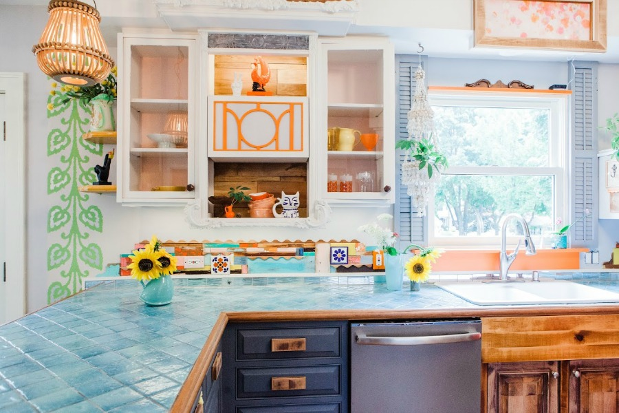 Turquoise, orange, and spring green in a kitchen. Be inspired by this photo gallery of vibrant colorful beachy boho interior design from artist Jenny Sweeney's Chicagoland home. Her art has been lifting spirits and opening hearts to wonder - see how it lives large in a charming suburban Tudor!