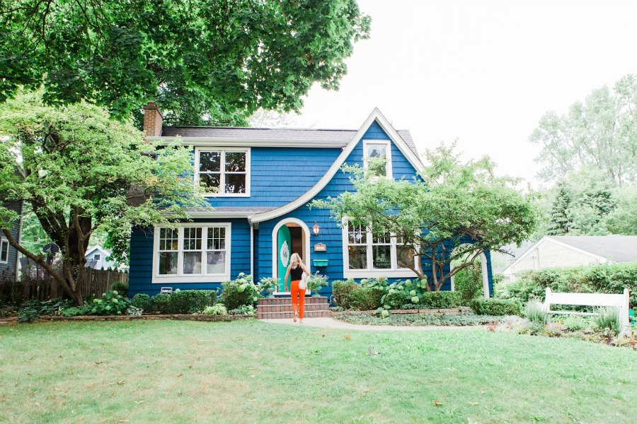 Tudor exterior - Be inspired by this photo gallery of vibrant colorful beachy boho interior design from artist Jenny Sweeney's Chicagoland home. Her art has been lifting spirits and opening hearts to wonder - see how it lives large in a charming suburban Tudor!