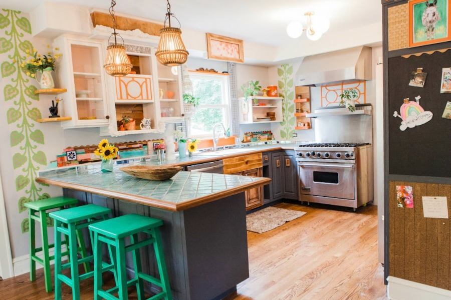 One of a kind kitchen! Be inspired by this photo gallery of vibrant colorful beachy boho interior design from artist Jenny Sweeney's Chicagoland home. Her art has been lifting spirits and opening hearts to wonder - see how it lives large in a charming suburban Tudor!