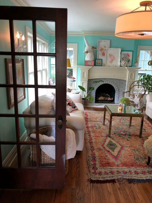 Turquoise walls in living room. Be inspired by this photo gallery of vibrant colorful beachy boho interior design from artist Jenny Sweeney's Chicagoland home. Her art has been lifting spirits and opening hearts to wonder - see how it lives large in a charming suburban Tudor!