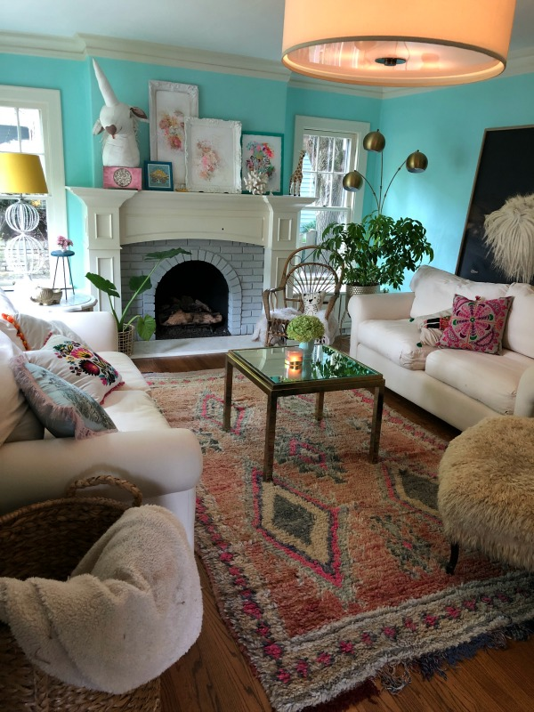 Turquoise painted living room. Be inspired by this photo gallery of vibrant colorful beachy boho interior design from artist Jenny Sweeney's Chicagoland home. Her art has been lifting spirits and opening hearts to wonder - see how it lives large in a charming suburban Tudor!