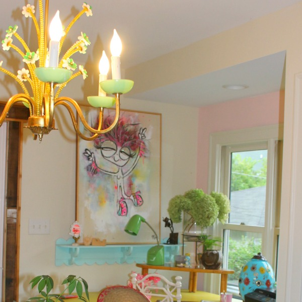 Colorful, cheerful, beachy boho office area with vintage chandelier and art by Jenny Sweeney. #colorfuldecor #pinkwalls #interiordesign #vintagestyle #bohochic