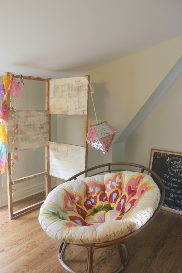Floral printed apasan chair in a quirky beachy boho bedroom by Jenny Sweeney.