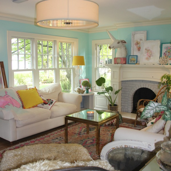 Colorful living room painted a bright cheerful turquoise blue - design by Jenny Sweeney. Time to Paint Your Walls? Come discover a Refresher to Demystify the Process!