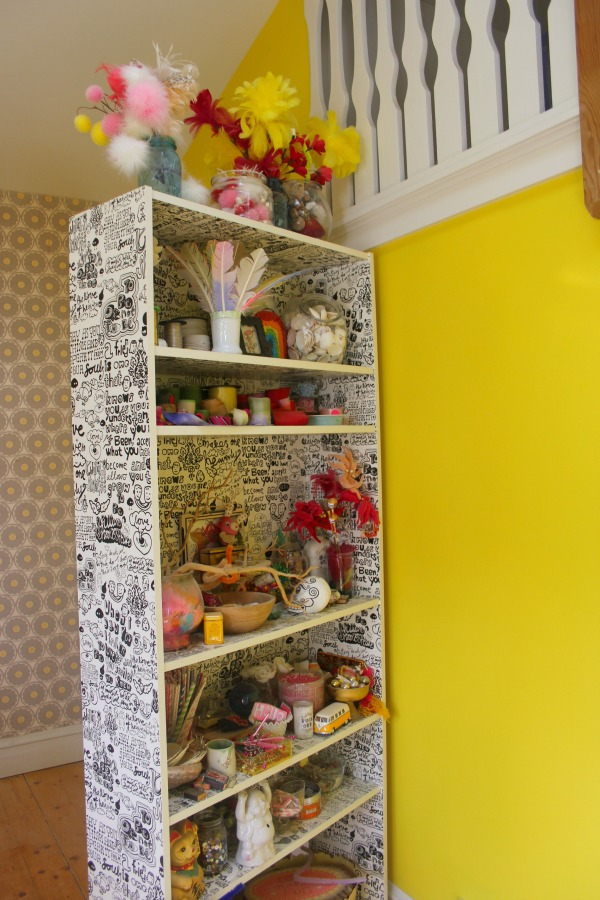 Neon yellow walls in the cheerful and eclectic colorful studio of Jenny Sweeney.