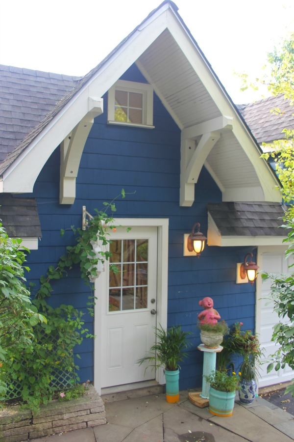 Vibrant blue exterior of the artist studio (climbing with ivy!) of Jenny Sweeney in Libertyville, IL. #cottage #colorfuldesign #climbingvines