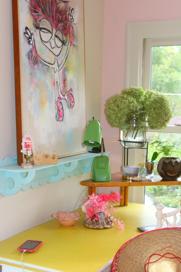Candy pink painted walls, whimsical art, and colorful vintage treasures mix in an office nook by Jenny Sweeney. Time to Paint Your Walls? Come discover a Refresher to Demystify the Process!