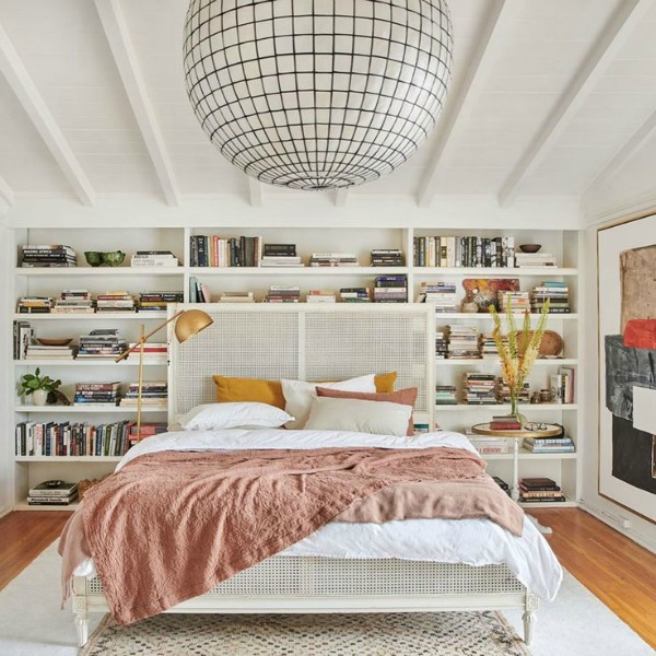 Leanne Ford's bedroom with white built-in shelves, Matteo linens, and overscaled light. Photo by Tessa Neustadt.