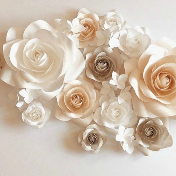 Handmade paper flowers for beautiful feminine wall decor for a bedroom or child's nursery. #handmade #paper #flowers