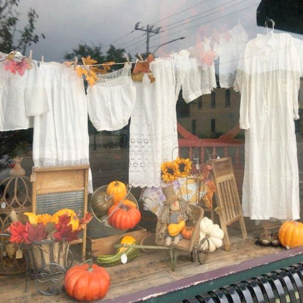 Pick a Dilly Antiques in Rockton, IL - the shop window looks darling with its clothesline of white linens and fall pumpkins.