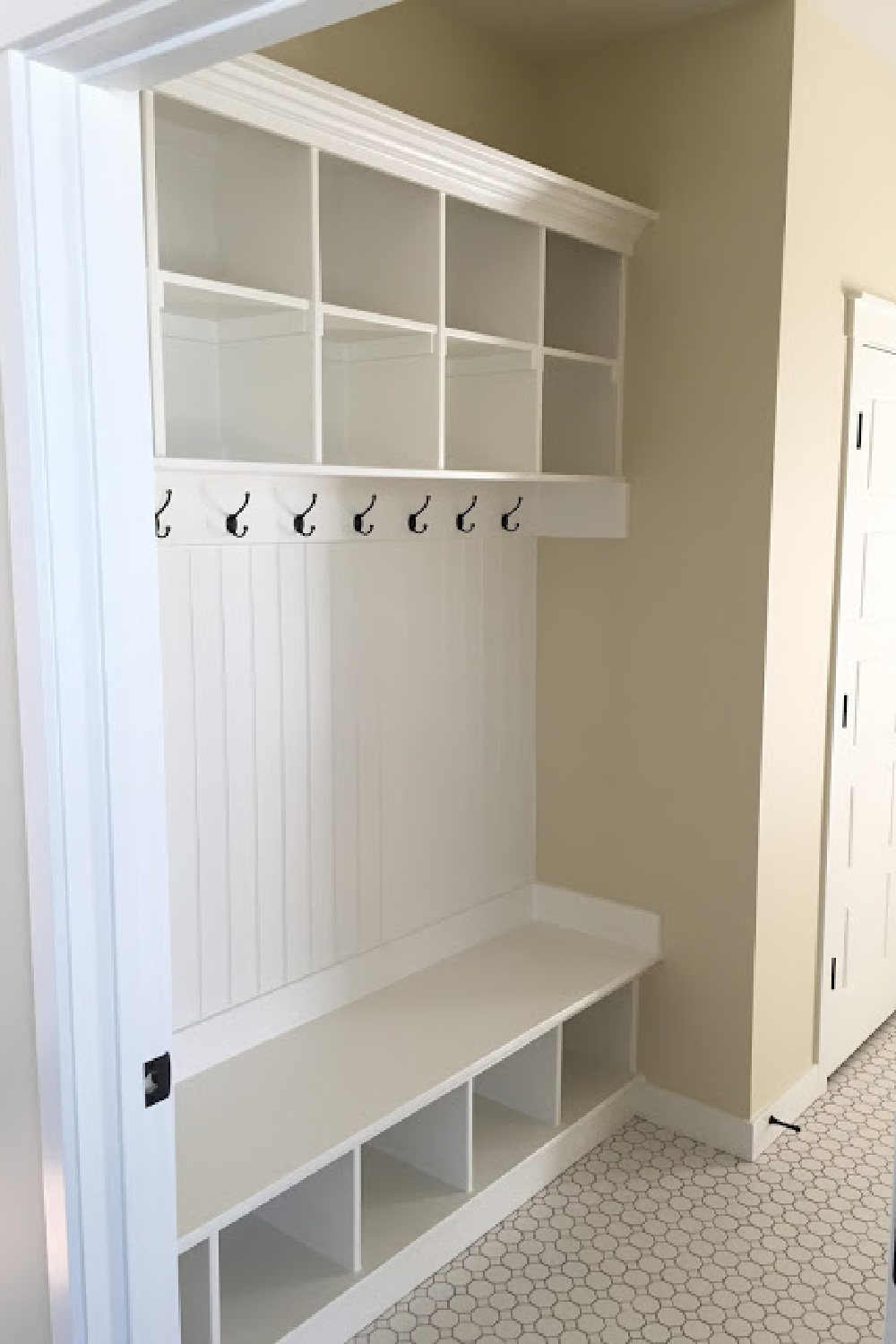 PPG Delicate White paint color on built-ins in a mud room by designer Andrea West. #delicatewhite #paintcolors #mudroom