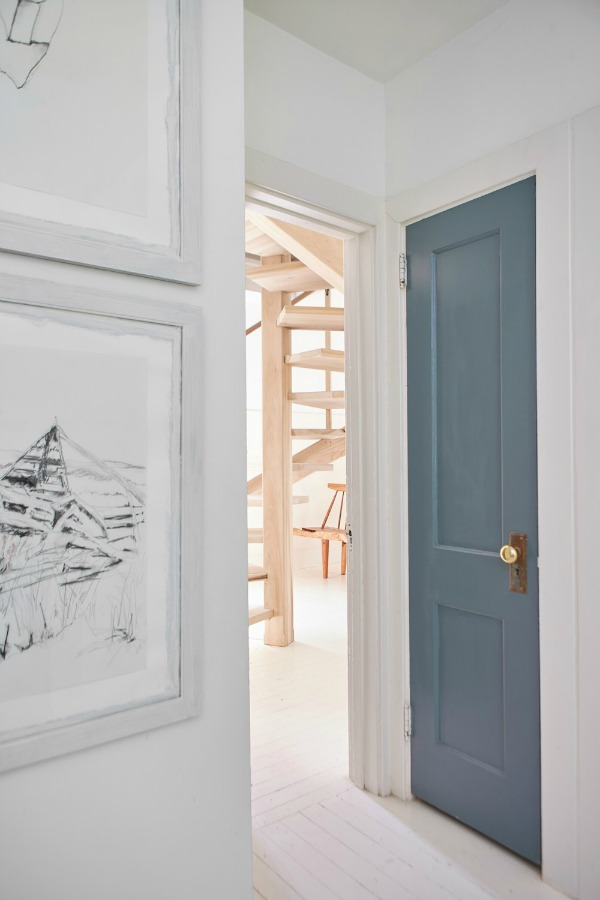 In the staircase room a door is painted PPG Phantom - as part of the Smith project on HGTV's Restored by the Fords with design by Leanne Ford. #paintcolors #interiordesign #ppg #phantom #leanneford #restoredbythefords