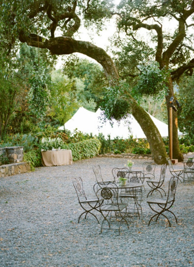 Beautiful pea gravel courtyard for fall wedding with floral decor by Sarah Winward and photography by Kate Osborne.