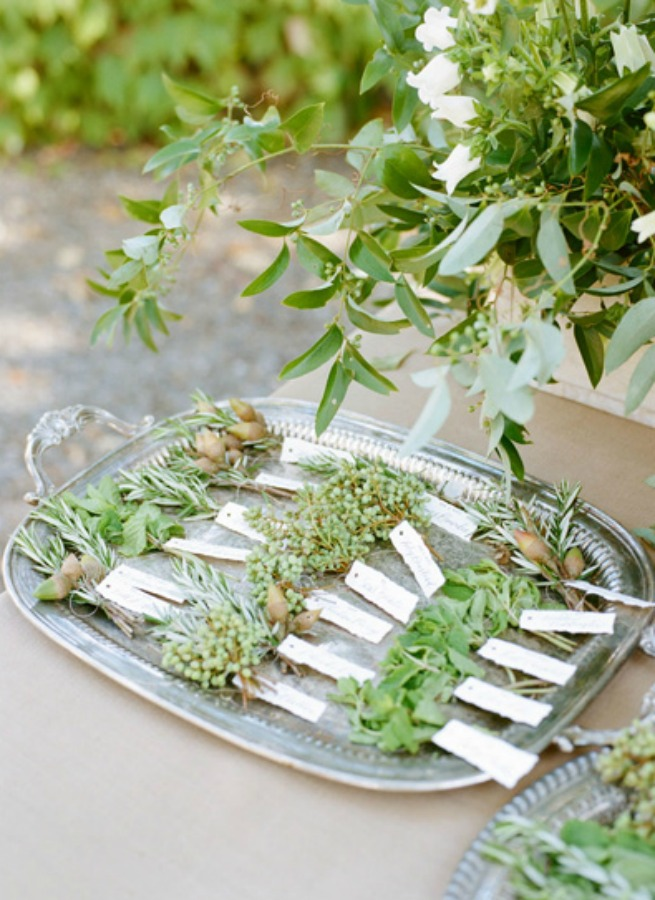 Succulent table numbers at a fall wedding with floral decor by Sarah Winward and photo by Kate Osborne.