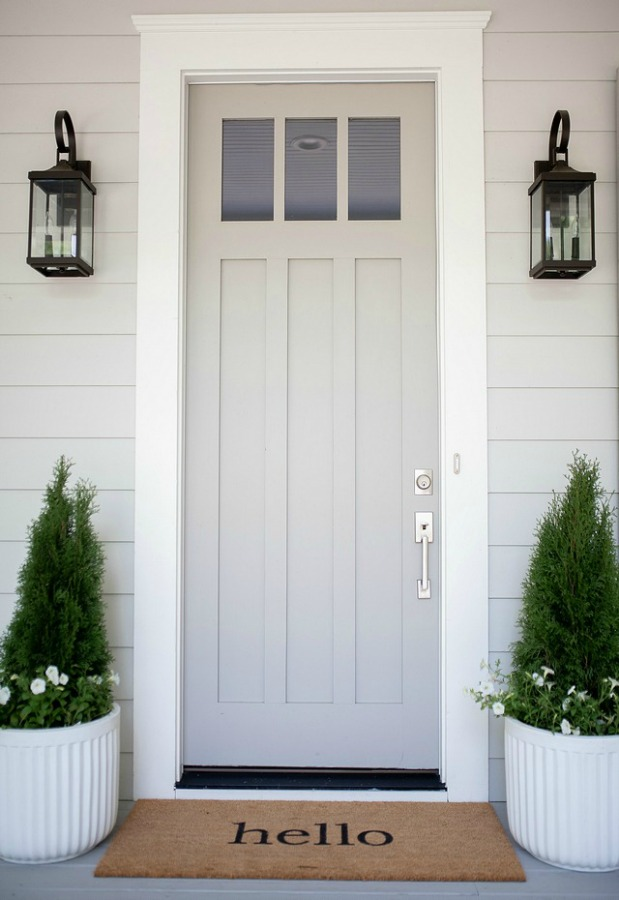 Repose Gray by Sherwin Williams paint color on the siding and Dorian Gray painted front door by Bell Sheep Studio. #paintcolors #bestgrey #doriangray #reposegray #interiordesign